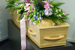 Coffin in morgue. A coffin in a morgue with a flower arrangement Stock Photos