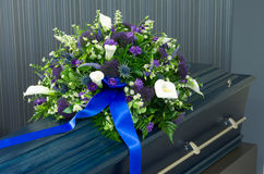 Coffin in morgue. A blue coffin in a morgue with a flower arrangement Royalty Free Stock Photography