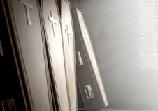Coffin Row In A Room. A row of upright wooden coffins against a wall in a dilapidated room lit by light through a window - 3D Render- 3D Render Stock Photography