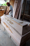 Coffins. Craftsman is finalizing a coffin in the city of Solo, Central Java, Indonesia Royalty Free Stock Photo