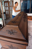 Coffins. Craftsman is finalizing a coffin in the city of Solo, Central Java, Indonesia Royalty Free Stock Image