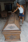 Coffins. Craftsman is finalizing a coffin in the city of Solo, Central Java, Indonesia Royalty Free Stock Photos