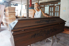 Coffins. Craftsman is finalizing a coffin in the city of Solo, Central Java, Indonesia Royalty Free Stock Images