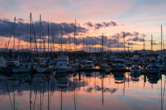 Coffs Harbour bay with yachts, boats at dusk. Coffs Harbour beautiful marina view, sailboats, yachts and motorboats Stock Photo