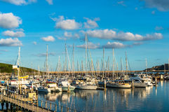 Coffs Harbour bay with yachts, boats on sunny day. Beautiful Coffs Harbour marina view, sailboats, yachts and motorboats Stock Photo