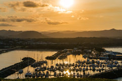 Coffs Harbour beautiful marina view, sailboats. Coffs Harbour bay with yachts, boats at sunset with sun reflection on the water Royalty Free Stock Photos