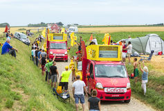 Cofidis Caravan on a Cobblestone Road- Tour de France 2015 Royalty Free Stock Photos