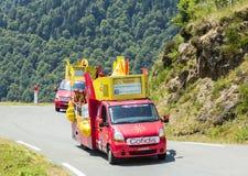 Cofidis Caravan in Pyrenees Mountains - Tour de France 2015. Col D'Aspin,France- July 15,2015: Cofidis Caravan during the passing of the Publicity Caravan on the Stock Images