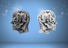 Cog heads with bright background. Digital composite of Cog heads with bright background Stock Photo