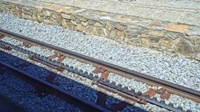 Cog railway tracks in motion. Cremallera train of Nuria in the spanish Pyrenees. Cog railway tracks with an additional toothed rack located in the middle of the stock footage
