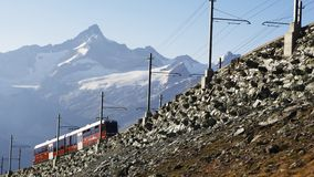 Cog railway up to the peaks of the Alps royalty free stock images