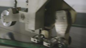 Cog-Wheel Machine Cuts Steel Sheet in Work Shop Closeup. Closeup metal machine with cog-wheel cuts steel sheet in powerful tire production enterprise stock video