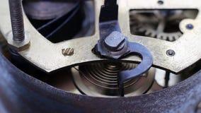Cog-wheel. Macro footage of a ticking vintage clockwork stock footage