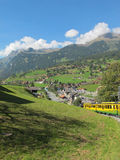 Cog-wheel Train And Village View In Switzerland Stock Image