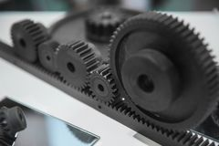 Cog wheels against white background stock images