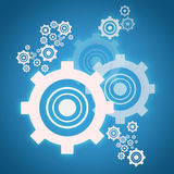 Cog wheels on blue background Royalty Free Stock Images