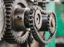 Cog wheels in the machine. In paper box industry Royalty Free Stock Photos