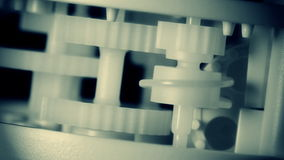 Cog wheels. Part of gears in a mechanical clock stock footage