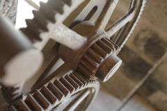 Cog wheels and steam. Technology illustrating power with gear train (cog) wheels and a puff of steam, blurred background Royalty Free Stock Image