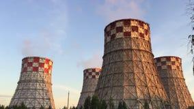 Cogeneration power plant in city. Thermal Power Station chimney smoke sky. Close-up. Sunset landscape. Combined heat. Power plant near megapolis. Chimney-stalk stock footage