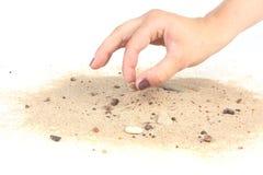 Coger la piedra de la arena en el fondo blanco fotografía de archivo libre de regalías
