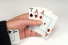 Cogger. Cards in a hand and an ace in a sleeve Royalty Free Stock Photos