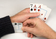 Cogger. Cards in a hand and an ace in a sleeve Royalty Free Stock Images