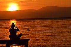 Cogida de la puesta del sol Imagen de archivo libre de regalías
