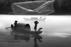 Cogida de los pescados de la madrugada Fotografía de archivo libre de regalías