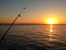 Cogida de una puesta del sol Fotos de archivo libres de regalías