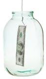 Cogiendo 100 dólares de billete de banco del tarro de cristal Fotografía de archivo libre de regalías