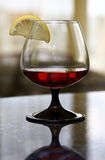 Cognac. Image of glass with cognac and lemon Royalty Free Stock Image