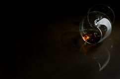 Cognac. In the big glass on a dark background Stock Images