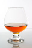 Cognac. In classic glass with drops Stock Images