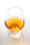 Cognac. In classic glass with drops Royalty Free Stock Image