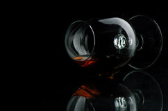 Cognac. In the big glass on a dark background Stock Photo