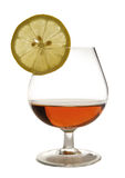 Cognac. In a glass, with lemon Royalty Free Stock Photo