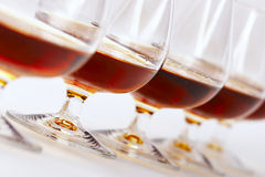 Cognac. 's glasses line Royalty Free Stock Photos