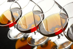 Cognac. Line glases of brandy for party Royalty Free Stock Photo