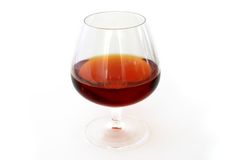 Cognac. Glass on white royalty free stock image