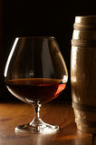 Cognac and barrel Stock Images