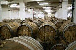 Cognac barrels. Row of wooden brandy barrels in wine cellar Yerevan Armenia Stock Photo