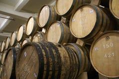 Cognac barrels. Row of wooden brandy barrels in wine cellar Yerevan Armenia Royalty Free Stock Image