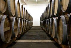 Cognac barrels. Row of wooden brandy barrels in wine cellar Yerevan Armenia Stock Photos