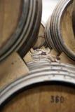 Cognac barrels. Row of wooden brandy barrels in wine cellar Yerevan Armenia Royalty Free Stock Images