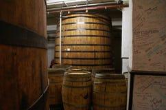 Cognac barrels. Row of wooden brandy barrels in wine cellar Yerevan Armenia Stock Images
