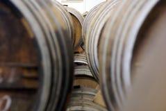 Cognac barrels. Row of wooden brandy barrels in wine cellar Yerevan Armenia Royalty Free Stock Photos