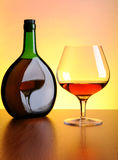 Cognac bottle and glass Royalty Free Stock Image