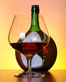 Cognac bottle and glass Stock Image