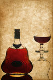 Cognac bottle and glass Stock Images
